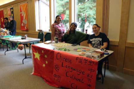 Students in the Chinese club table at an event