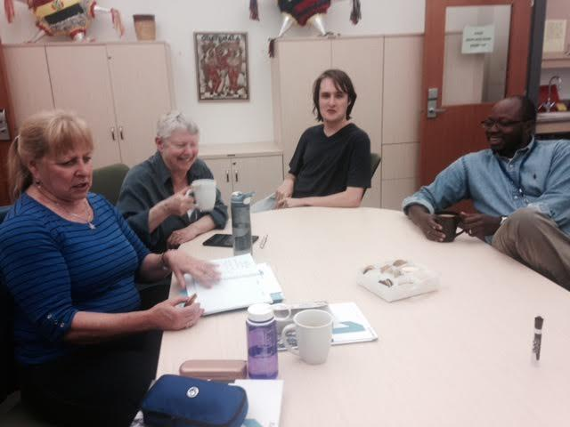 Members of club francophone share cookies and coffee with French program leader, Joseph Diémé